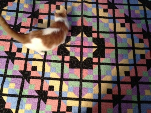 Colby Jackson helping me lay the quilt out. Handpieced by me!